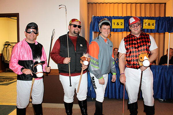 "Chamber members Brian Gossard, left, Jeff Fritz, Andrew Mancinotti and Michael Mesker came prepared for horse racing Saturday evening for the Delphos Area Chamber of Commerce's annual dinner. Mesker won ""Best Jockey."" His prize was a standing cooler. (DHI Media/Nancy Spencer)"