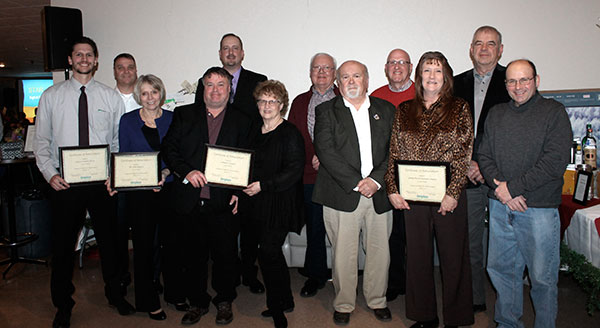 Chamber members receiving membership plaques for longevity were, front from left, Josh Miller, Western-Southern Life, 130 years; Doris Neumeier, The Union Bank Co., 125; Chris and Marthanne Lehmann, Lehmann Furniture, 70; and Dan Duncan, Barb Coil and Dave Musgrave, German Mutual Company, 155; and back, Mick Murphy, Vancrest of Delphos, 55; Gary Wenzlick, Fort Jennings Telephone, 110; and Mike Schimmoeller, Gary Miller and Ed Etzkorn, German Mutual.