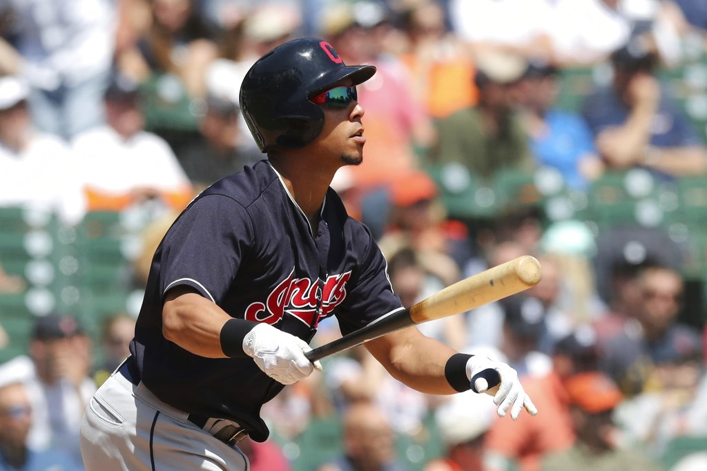 Cleveland Indians' Michael Brantley watches his solo home run clear the right field wall during the fifth inning of a baseball game against the Detroit Tigers, Wednesday, May 16, 2018, in Detroit. (AP Photo/Carlos Osorio)