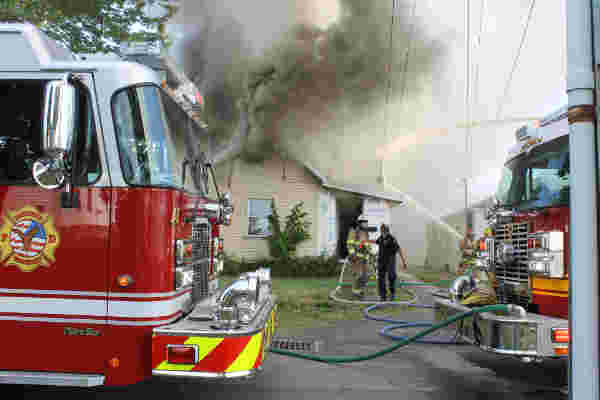 Firefighters battle a house fire on Clime Street Wednesday afternoon. (DHI Media/Nancy Spencer)