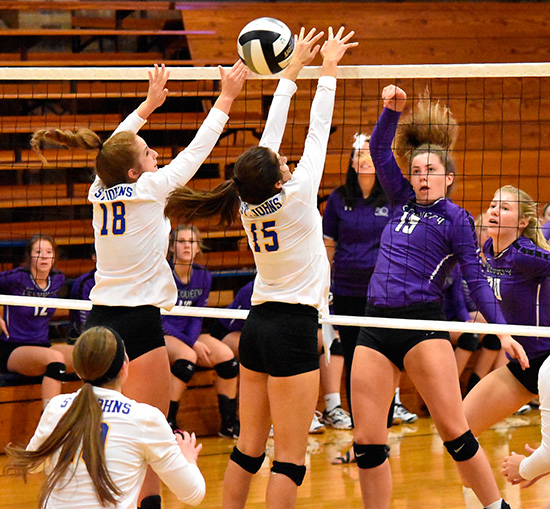 Madison Rammel of Fort Recovery sends the ball past Brianna Altenberger (18) and Melanie Koenig (15) in Delphos Thursday. (DHI Media/Joe Dray)