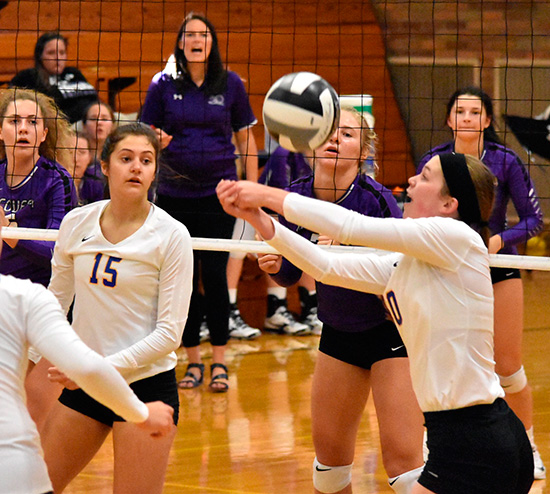 Erika Moenter sets the ball for Melanie Koenig of St. John's in Thursday's game. The Lady Jays fell to #3 Fort Recovery in three sets. (DHI Media/Joe Dray)