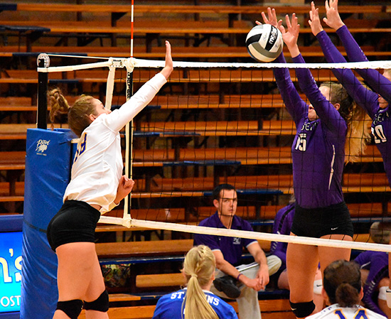 Brianna Altenberger of St. John's goes for a kill against Madison Rammel of Fort Recovery. The Jays lost in three straight sets. (DHI Media/Joe Dray)
