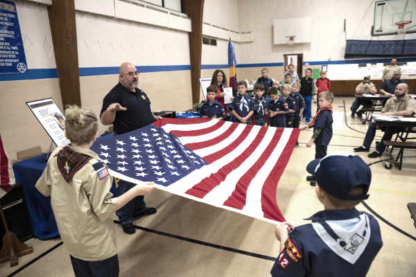 The Scouts were able to participate in an official flag-folding and learn about how to properly treat, display and dispose of the flag. (Submitted photo)