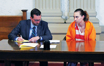 Jessica McClure sits next to her attorney Alex Treece during her arraignment hearing. (File photo)