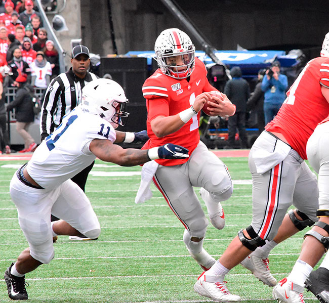 Ohio State quarterback Justin Fields busts through the line on his way to the endzone in Saturday's game. (DHI Media/Joe Dray)