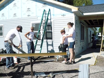 Employees from Charles Rivers Laboratories in Spencerville volunteer their time to assist with installing siding on the Habitat for Humanity House. Pictured working on cutting, placing and securing siding to the house are, from left, Scott Sanderson, Lindsay Langhals, Marge Broecker and Melissa Schroeder. Sanderson said the company allows workers one paid day off per year to volunteer their time for a good cause. Roger Calvert said that the caulking, electrical, roofing and insulation are done. Next week, he is looking for a good crew of locals for the drywall work and installation of the duct work. Volunteers work at the site on Wednesday and Saturday mornings starting at 8 a.m. and are always needed. Anyone interested in helping in the building process is required to complete a brief online volunteer training process at habitatlima.org. Contact Calvert at 419-733-7193 or by email   <script language='JavaScript' type='text/javascript'><div class='imageDescription'></div></div></a>  <!--  var prefix = 'm&#97;&#105;lt&#111;:';  var suffix = '';  var attribs = '';  var path = 'hr' + 'ef' + '=';  var addy84270 = 'r&#111;g&#101;r' + '&#64;';  addy84270 = addy84270 + 'h&#97;b&#105;t&#97;tl&#105;m&#97;' + '&#46;' + '&#111;rg';  document.write( '<a ' + path + '\'' + prefix + addy84270 + suffix + '\'' + attribs + '>' );  document.write( addy84270 );  document.write( '<\/a>' );  //-->  </script><script language='JavaScript' type='text/javascript'>  <!--  document.write( '<span style=\'display: none;\'>' );  //-->  </script>This e-mail address is being protected from spambots. You need JavaScript enabled to view it.  <script language='JavaScript' type='text/javascript'>  <!--  document.write( '</' );  document.write( 'span>' );  //-->  </script>. (Delphos Herald/Stephanie Groves)