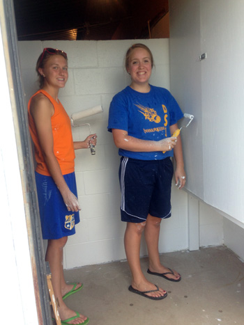 Delphos Pathfinders 4-H Club members Colleen Schulte and Samantha Bonifas paint the bathrooms at Babyland at the Van Wert County Fairgrounds. The pair are getting things nice for next week when the fair starts. (Submitted photo)