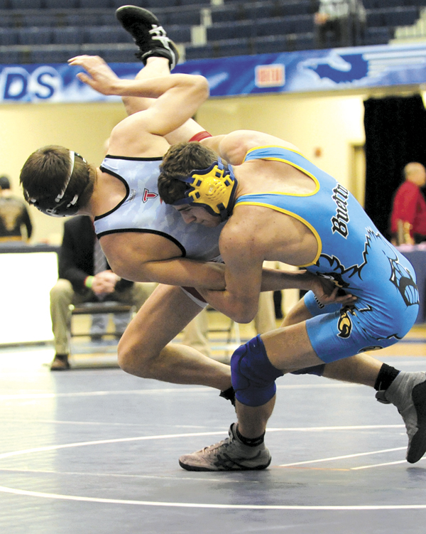 In the 170-pound class, St. John's Will Buettner and Bobby Sunderhaus (LCC) battled for the Kettering Fairmont District Championship Sunday. Despite this attempted throw by Buettner, Sunderhaus grabbed the 9-0 win.