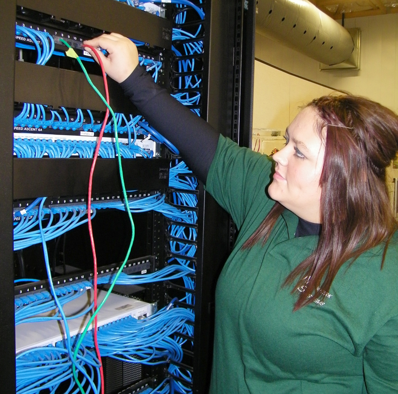 Vantage Network Systems junior, Audrey Smith from Wayne Trace, verifies the connection on the network distribution panel in lab.