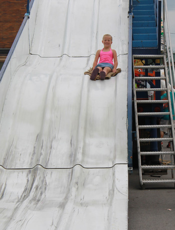 Spencerville Summerfest activities culminated on Saturday. Above: Olivia Banschoyck, 6, slides down the giant slide. (Delphos Herald/Stacy Taff)