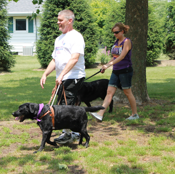 Grand Marshals Bob Ulm and Pippa round the bend at the track at Leisure Park during the Bark For Life event held on Saturday. To date, the campaign has raised over $7,000.