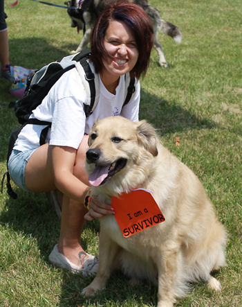 Cancer survivor Moses and his pet parent Melissa Deal from Wapakoneta participate in Saturday's Bark For Life held at Leisure Park. Moses was a rescue from New Orleans in 2009 and developed a cancerous ear tumor in 2010. Since treatment, Moses is doing fine. (Delphos Herald/Stephanie Groves)