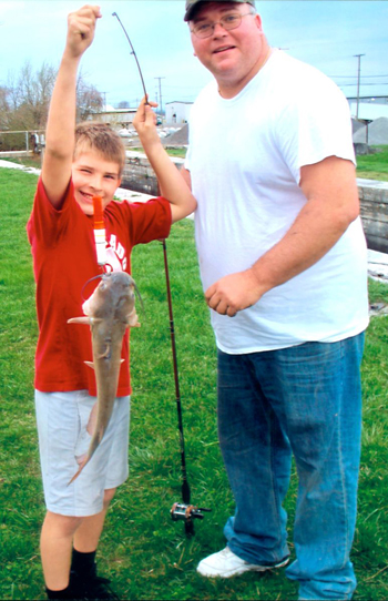Catch of the day: Brady Zalar, left, a 10-year-old from Delphos, recently caught this catfish while fishing the Miami-Erie Canal with his dad, Dave Zalar. (Photo submitted)