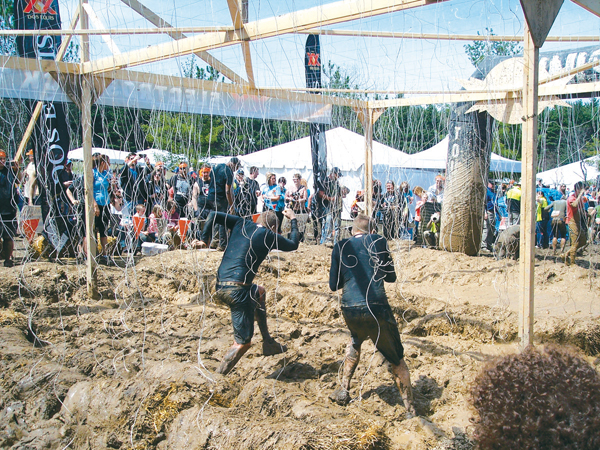 Tough Mudders slog through a mud pit to raise money for the Wounded Warriors. (Submitted photos)