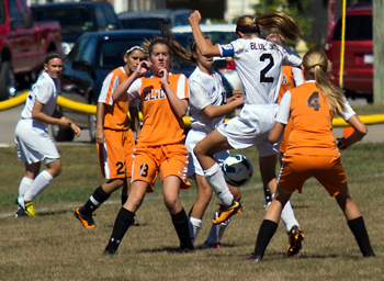 St. John's Jessica Koverman (10 in white) and Samantha Bonifas battle Elida's Kyleigh Gay (8) and Courtney Siefker for possession during girls soccer action Saturday at the Annex. (Delphos Herald/Randy Shellenbarger)