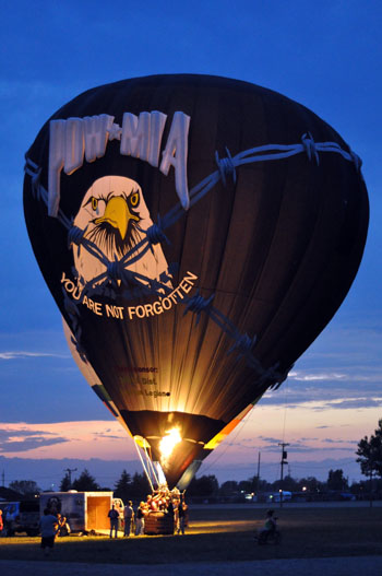 The POW/MIA balloon lights up Saturday evening at the Van Wert Hot Air Festival. The festival wrapped up Sunday after a weekend of festivities. Although strong winds prevented some balloon launches on Saturday afternoon, overall the weather allowed for a successful festival. (Times Bulletin/Lindsay McCoy)