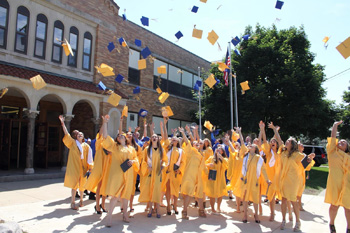 St. John's High School held graduation for 51 seniors Sunday in the Robert A. Arnzen Gymnasium. Above: Graduates celebrate with a toss of their caps. (dhi MEDIA/Dena Martz)