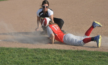 Columbus Grove's Kyrah Yinger slides back into third base on a pickoff attempt as Fairview's Kelsey Beck applies a late tag. (dhiMEDIA/Charlie Warnimont)
