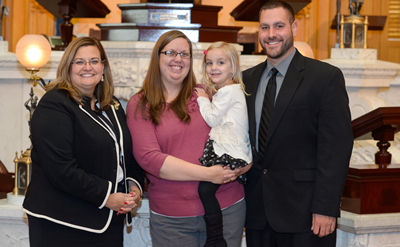 Senator Shannon Jones, left, stands with Delphos natives Kendra and Brad Klausing and their daughter, Hallee, after the Klausings testified at a SIDS hearing at the Ohio Statehouse. The Klausings lost a daughter to SIDS in November 2006. (Submitted photo)