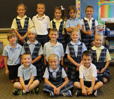 Delphos St. John's Elementary First-grade Class A students include, front from left, Brayden Buettner, Emma Wiltsie and Tyler Lindeman; middle row, Kayla Beining, Alayna Wrasman, Isaiah Freewalt, Kierstin Jackson and Grace Meyer; and back row, Callie Shawhan, Alex Martz, Malania Hershey, Greyson Rode and Ellie Rahrig. Absent from the photo was Kaitlyn Dickman. (DelphosHerald/StephanieGroves)
