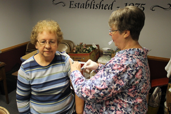 Community Health Professionals of Delphos held a Flu Shot Clinic at the Senior Citizens Center Thursday afternoon. Margaret Kaverman of Delphos stopped into the center to receive her annual immunization from Phyllis Kinkle, L.P.N. Call Community Health Professionals at 419-695-1999 or the county health department to schedule an immunization appointment. (Delphos Herald/Stephanie Groves)
