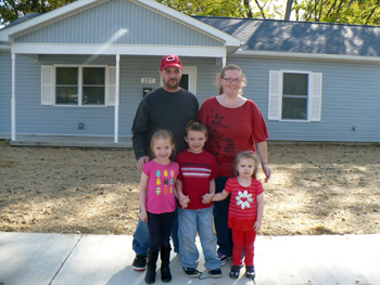 Tom Stanton Sr., back left, and Melanie Martin stand in front of their new Habitat home with the children, Leann, front left, Thomas Jr. and Samantha. (Delphos Herald/Nancy Spencer)