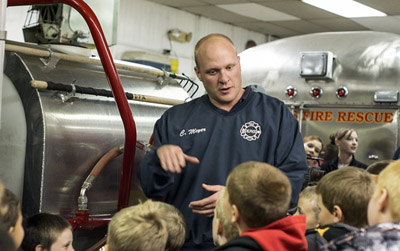 Firefighter/Paramedic Cory Meyers led the guided tour of the fire station for Delphos Tiger Cubs.. (Submitted photo)