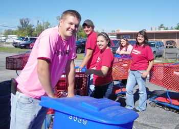 Vantage Student Ambassadors Kurt Hoersten (Jefferson), Cailah Rickard (Continental), Evan Prowant (Continental), Hannah Robach (Continental) and Audrey Smith (Wayne Trace) smile for the camera as they unload a truck full of food at the Day of Caring Food Drive.